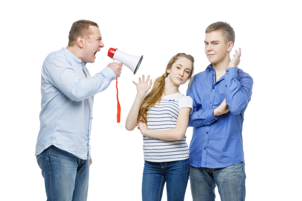 A father yelling at his teenage children about underage drinking.