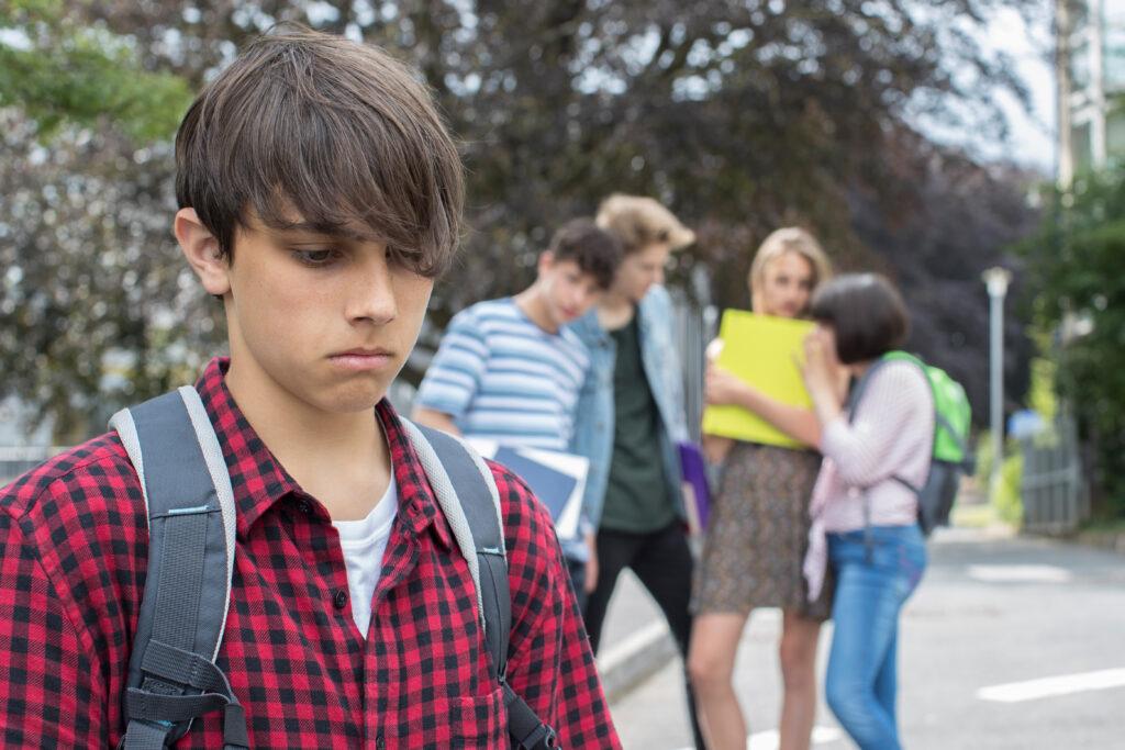 A teenage boy being peer pressured.